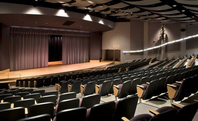 Comfortable, durable seating replaced outdated and damaged seating in Mosaic's theater design at Amsterdam High School.