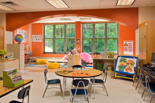 The colorful kindergarten rooms, featuring a prominent arch setting the stage for group reading and creative play, were key to Mosaic Associates Architects Shatekon Elementary School design.
