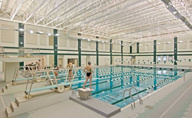 A separate deep-end space in the aquatic center Mosaic designed for Shenendehowa High School has four competitive diving boards. Bleachers accommodate 500 spectators.