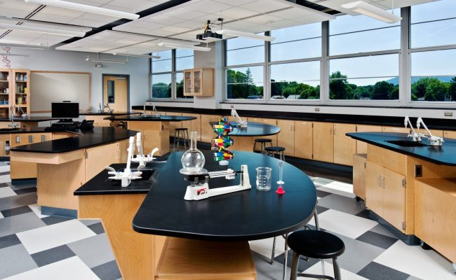 "Mosaic Associates used of ""teaching walls"" in the Glens Falls High School science wing to define laboratory and instructional spaces in the long classrooms, while larger tables are designed to serve as both lab tables and student desks."