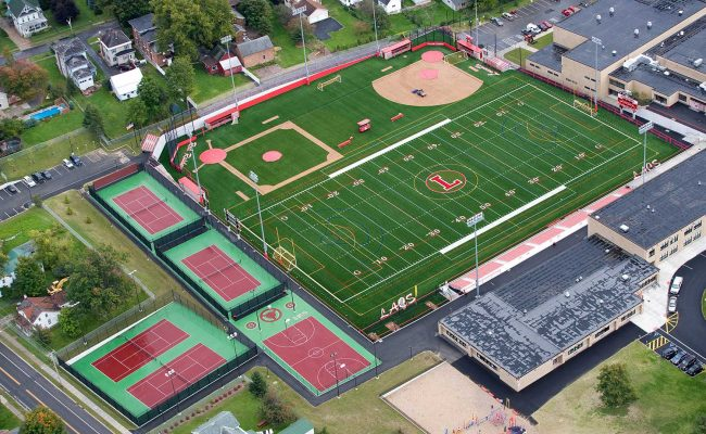 Mosaic's athletic complex design configured the existing athletic space to create more playing area, seating, parking, logical roads and drives and two inviting public entrances.
