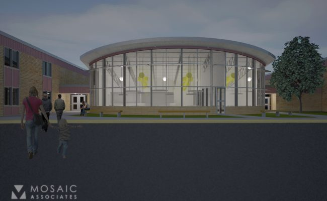 Mosaic's design for the library-media center addition at Roessleville Elementary has a prominent curved window wall and a raised roof and includes alterations to existing spaces for accessible toilet rooms, a faculty lounge and offices.