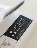 Mosaic Associates logo shown on an architectural blueprint.
