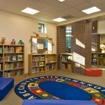 Colorful reading room featured in the Shatekon Elementary School design by Mosaic Associates Architects.