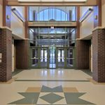 Front entryway featured in the Shatekon Elementary School design by Mosaic Associates Architects.